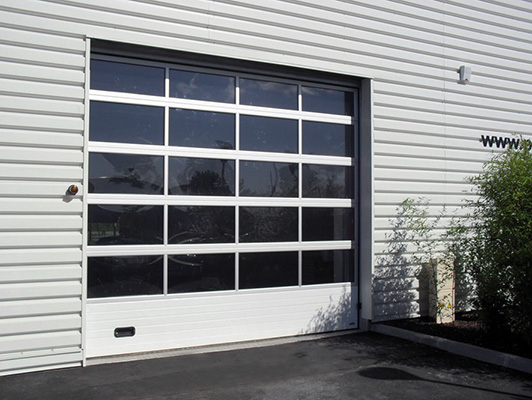 Portes de garage sg diffusion for Porte de garage sectionnelle 3 5 m