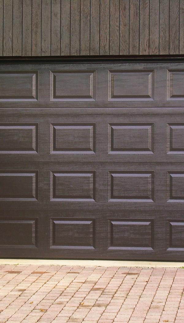 realisation-porte-de-garage-enroulable-sg-diffusion-installateur-pose-menuiseries-fermetures-oullins-lyon-rhone